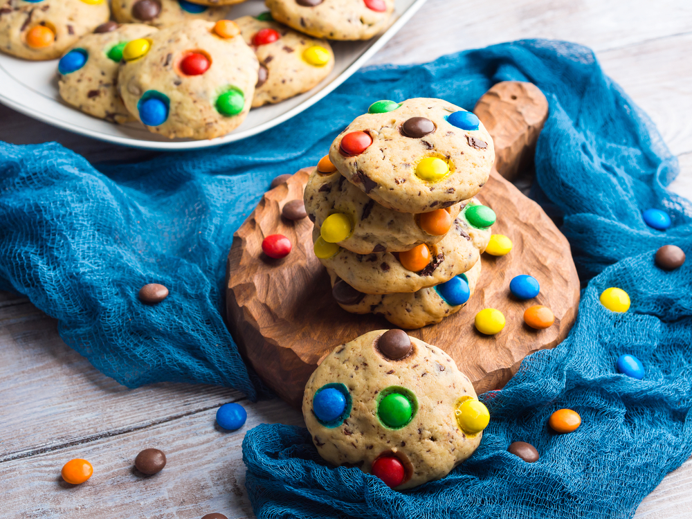 Stack,Of,Home,Made,Chocolate,Chip,Cookies,With,Rainbow,Candies